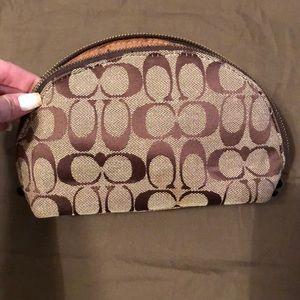Used coach material makeup bag